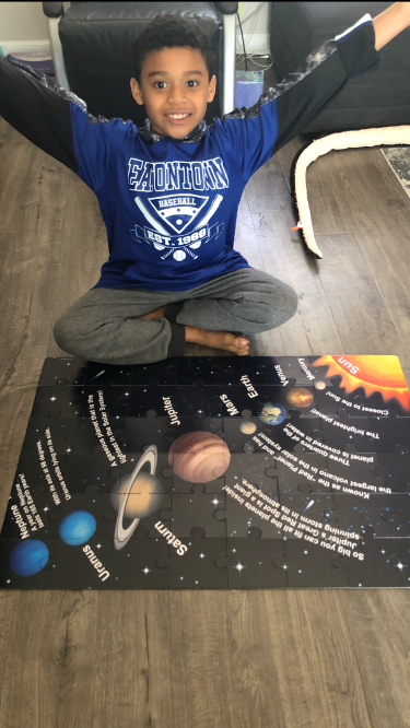 Mike learning about the planets